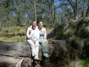 Sonja (L) and Tamasin (R) sitting on a 200 year-old fallen eucalyptus tree.