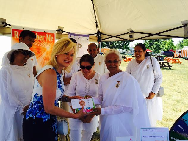 Mayor of Mississauga being presented a gift by BK Savi