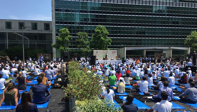 Public participating in International Day of Yoga event in fron of UNHQ, NY