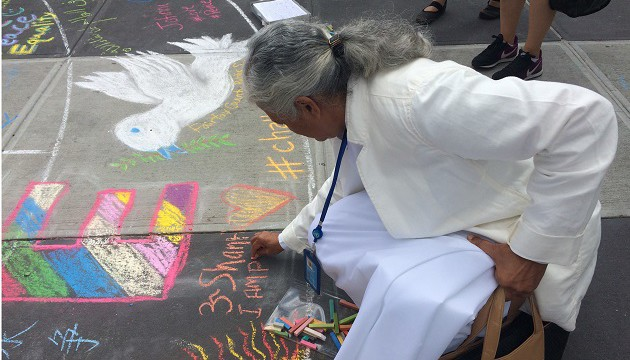 bk-gayatri-shares-a-message-of-peace-by-writing-om-shanti-on-a-peace-chalkwalk-on-intl-day-of-peace-edited