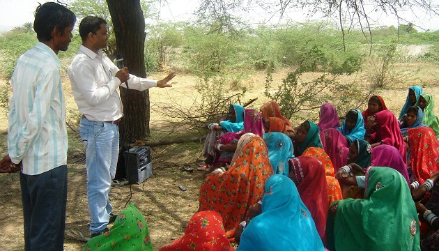 Radio Madhuban team educating rural women on Safety and Health at Work