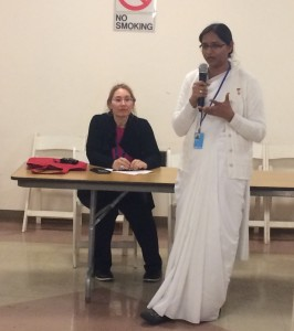 BK Tina Agarwal addressing the audience with Ms. Denise Scotto in the background
