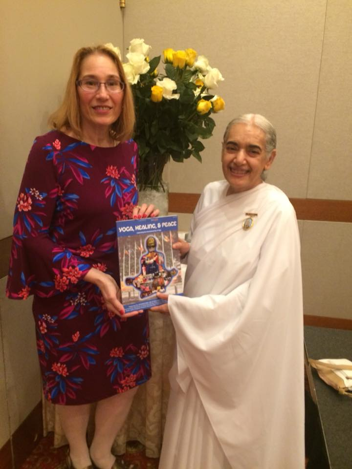 Sr. Jayanti being presente dthe Light on Light Yoga journal by Chair of the IDY Committee at the UN,